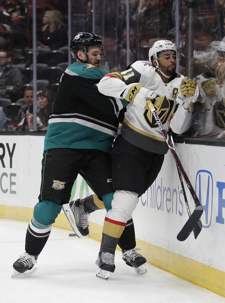 Anaheim Ducks' Korbinian Holzer, left, shoves Vegas Golden Knights' Pierre-Edouard Bellemare during the first period of an NHL hockey game Friday, March 1, 2019, in Anaheim, Calif. (AP Photo/Jae C ...