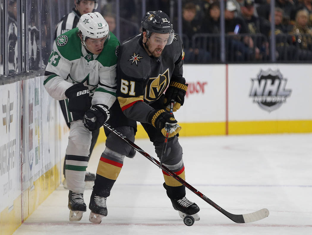 Dallas Stars center Mattias Janmark (13) vies for the puck with Vegas Golden Knights right wing Mark Stone (61) during the first period of an NHL hockey game Tuesday, Feb. 26, 2019, in Las Vegas. ...
