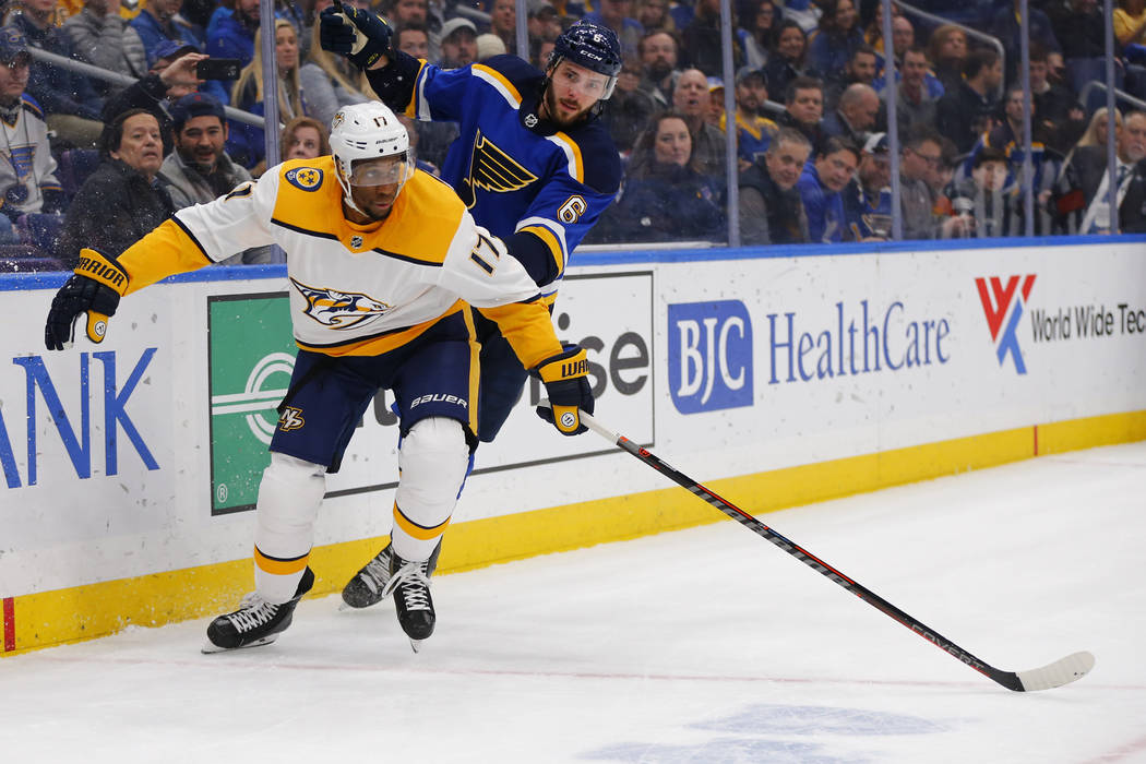 Nashville Predators' Wayne Simmonds (17) clears the puck against St. Louis Blues' Joel Edmundson (6) during the first period of an NHL hockey game Saturday, Feb. 26, 2019, in St. Louis. (AP Photo/ ...