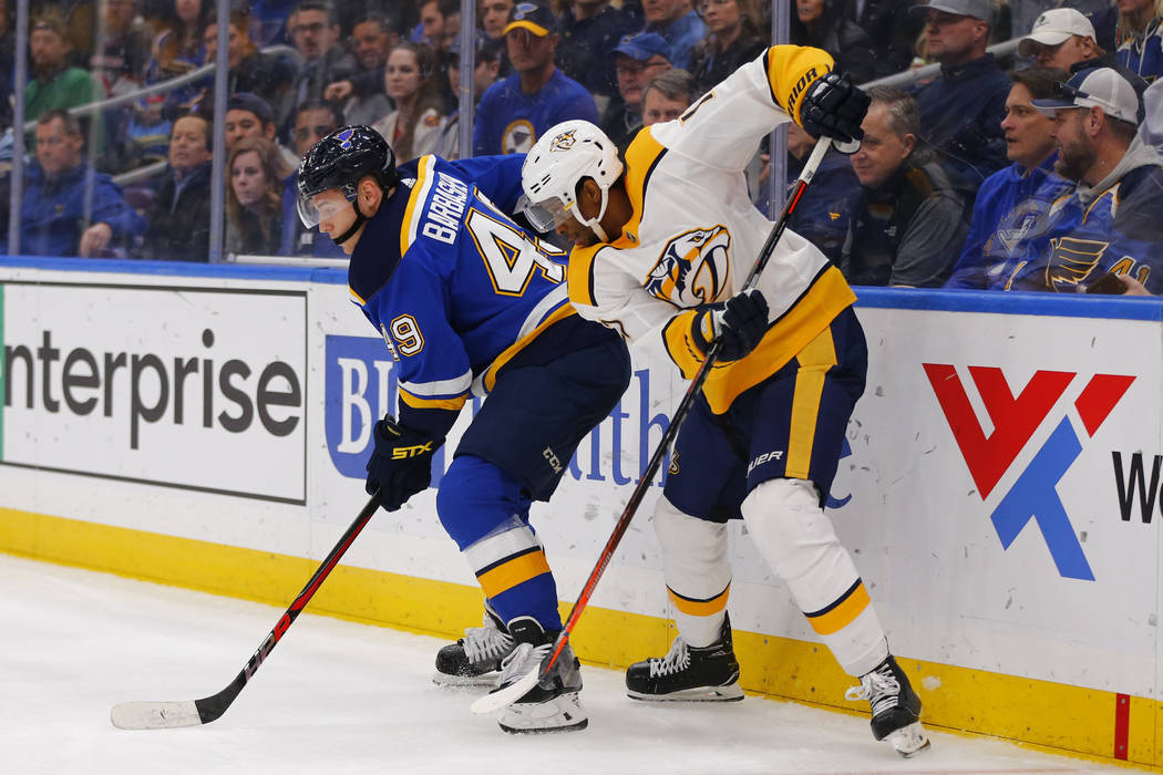 Nashville Predators' Wayne Simmonds (17) looks to steal the puck from St. Louis Blues' Ivan Barbashev (49) during the third period of an NHL hockey game Saturday, Feb. 26, 2019, in St. Louis. (AP ...
