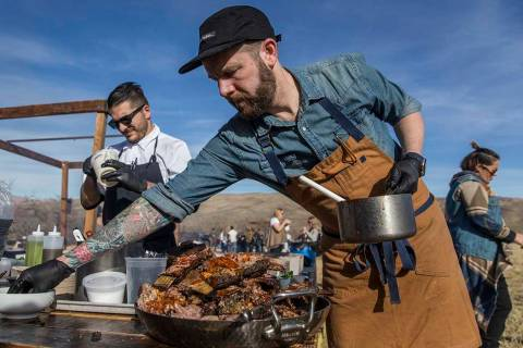 Momofuku's chef Shaun King, right, prepares lafah with slow-roasted short ribs during Whiskey in the Wilderness 2 on Jan. 14, 2018, at Spring Mountain Ranch State Park in Las Vegas. (Benjamin Hage ...