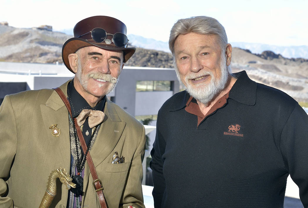 Doc Phineas, senior expert for antiquities for the History Channel and practitioner of feng shui, left, and Rich MacDonald, president and CEO of MacDonald Highlands are shown during a tour of a ho ...