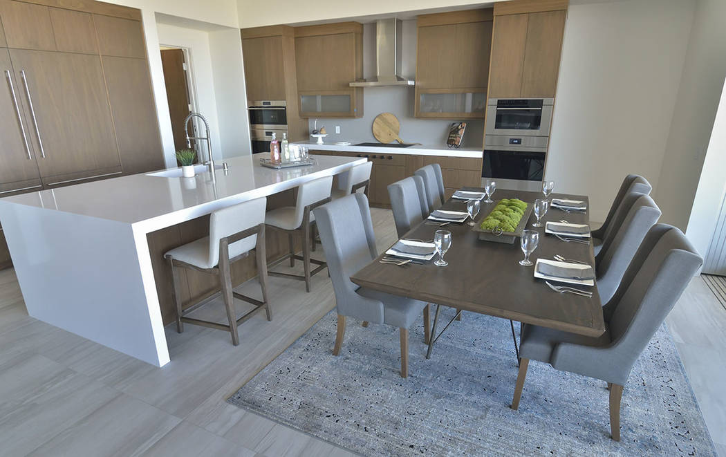 This kitchen is positioned in the ideal location of the home, in the southeast corner using the color white, which represents good feng shui. The green moss on the table can represent vitality and ...