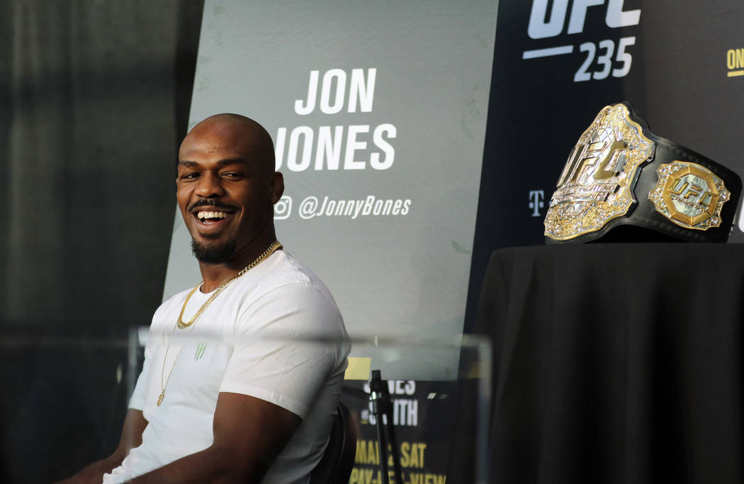 UFC light heavyweight champion Jon Jones reacts to a question asked at UFC 235 media day at the T-Mobile Arena in Las Vegas, Wednesday, Feb. 27, 2019. He will headline the fight card on March 2 ag ...