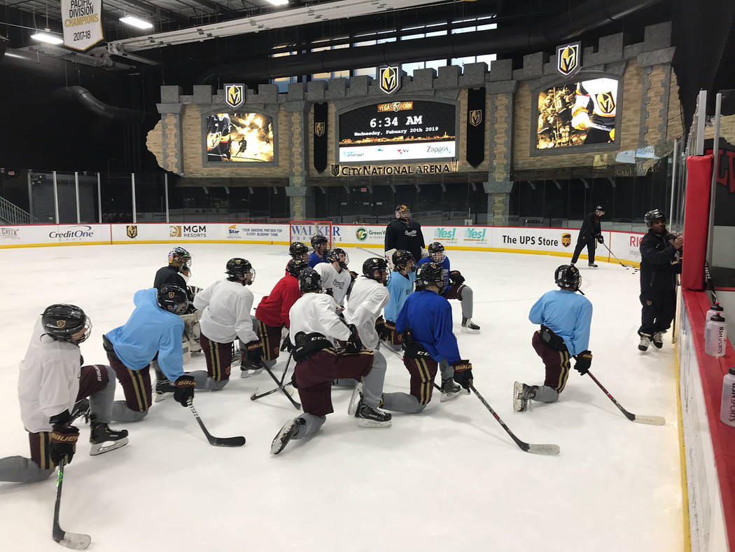 Faith Lutheran hockey coach Pokey Reddick conducts a blackboard session for the team on the rink at City National Arena. (Courtesy)