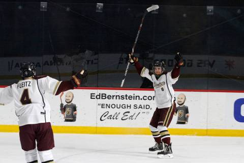 Faith Lutheran's Matty Johnson (8) celebrates with his teammate Colton Fleitz (4) after Johnson scored a goal against Utah's goaltender during the first period of a hockey game at the City Nationa ...