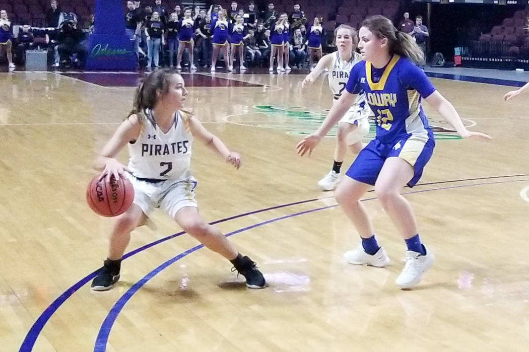 Moapa Valley's Andalin Hillstead handles the ball as Lowry's Sydney Connors defends in the Class 3A state semifinals at Orleans Arena on Friday, March 1, 2019. The Pirates won 43-38. (Damon Seiter ...
