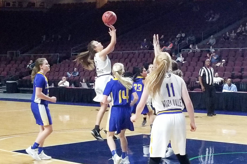 Moapa Valley's Lainey Cornwall takes a shot against Lowry in the Class 3A state semifinals at Orleans Arena on Friday, March 1, 2019. The Pirates won 43-38. (Damon Seiters/Las Vegas Review-Journal)