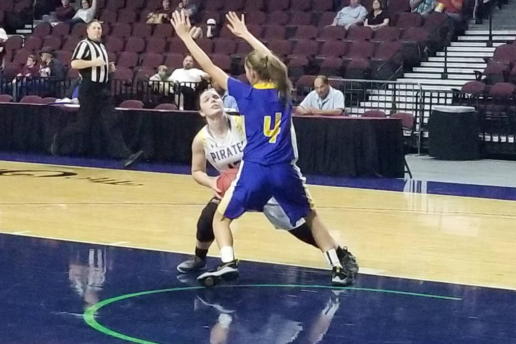 Moapa Valley's Lainey Cornwell looks for a shot against Lowry's Rebecca Kuskie in the Class 3A state semifinals at Orleans Arena on Friday, March 1, 2019. The Pirates won 43-38. (Damon Seiters/Las ...