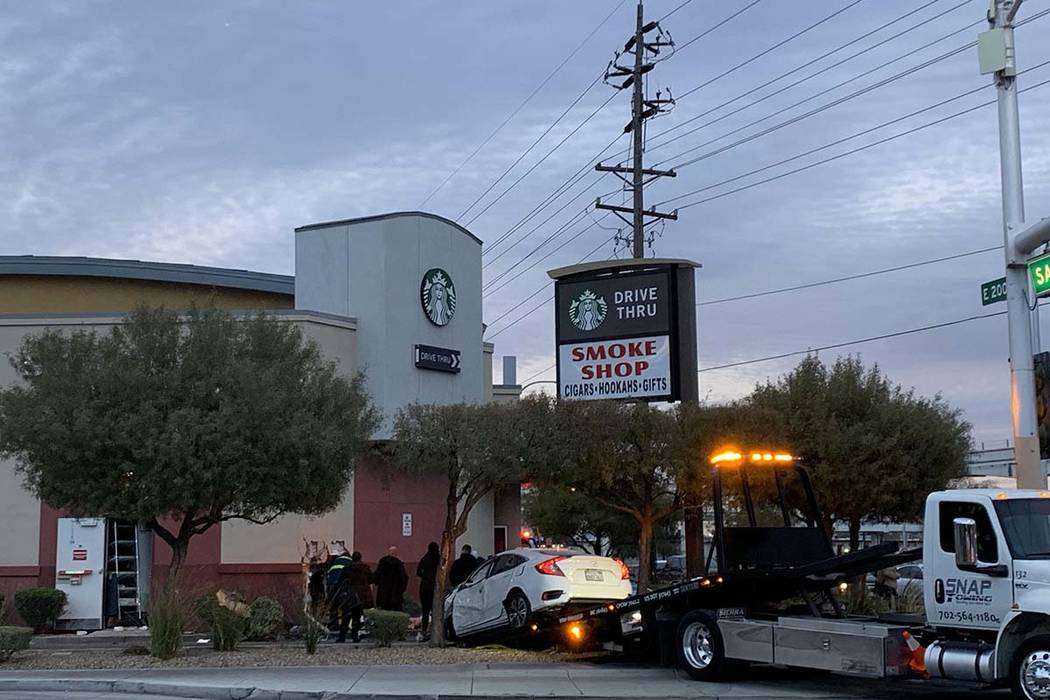 A car crashed into the wall of a Starbucks in its drive-thru lane at Sahara Avenue and Paradise Road, Friday, March 1, 2019. (Jessica Terrones/Las Vegas Review-Journal)