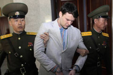 American student Otto Warmbier, center, is escorted at the Supreme Court in Pyongyang, North Korea on March 16, 2016. Warmbier died in June 2017 after he returned to the U.S. in a vegetative state ...