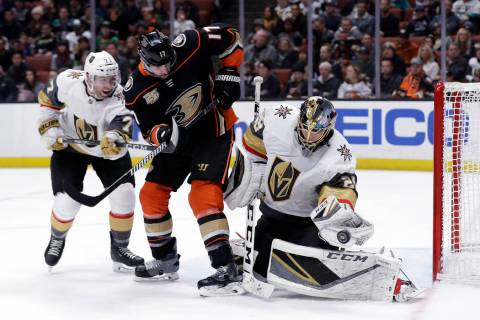 Vegas Golden Knights goaltender Marc-Andre Fleury, right, stops a shot next to Anaheim Ducks' Ryan Kesler (17) and Golden Knights' William Karlsson, left, during the second period of an NHL hockey ...