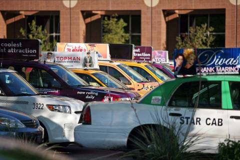 Cabs are parked outside of Grant Sawyer Building Monday, March 30, 2015, in Las Vegas. Southern Nevada taxi drivers and Uber supporters were among those who attended a hearing to discuss proposed ...