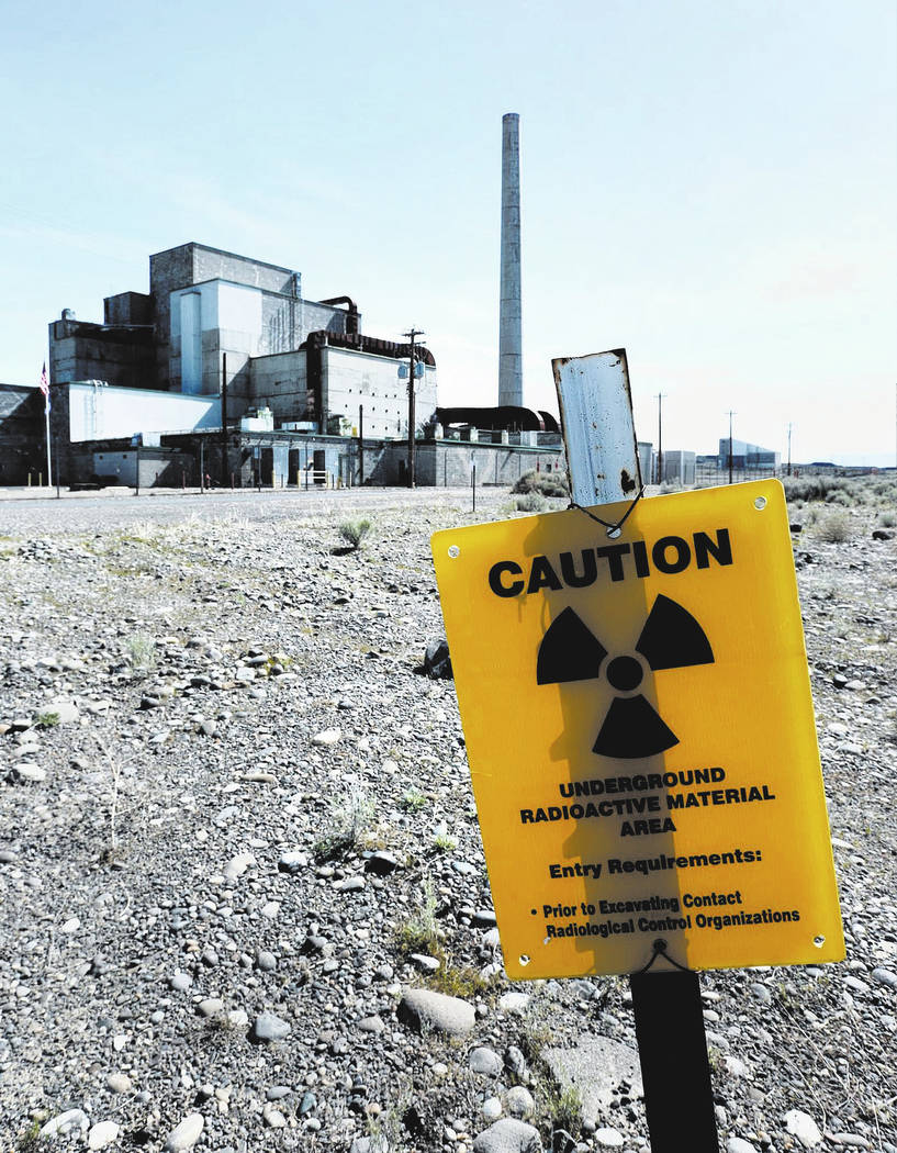 Signs remind visitors approaching the B Reactor on the Hanford Nuclear Reservation in south-central Washington in 2016. (Mark Boster / Los Angeles Times/TNS)
