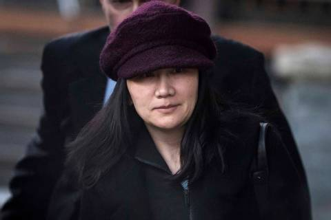 Huawei chief financial officer Meng Wanzhou leaves her home to attend a court appearance in Vancouver, British Columbia, Jan. 29, 2019. Canada said Friday, March 1, 2019, it will allow the U.S. ex ...