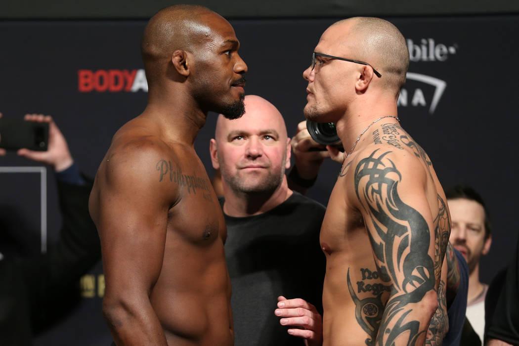 Jon Jones, left, and Anthony Smith, pose during the ceremonial UFC 235 weigh-in event at T-Mobile Arena in Las Vegas, Friday, March 1, 2019. (Erik Verduzco/Las Vegas Review-Journal) @Erik_Verduzco