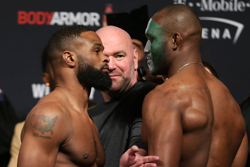 Tyron Woodley, left, and Kamaru Usman, pose during the ceremonial UFC 235 weigh-in event at T-Mobile Arena in Las Vegas, Friday, March 1, 2019. (Erik Verduzco/Las Vegas Review-Journal) @Erik_Verduzco