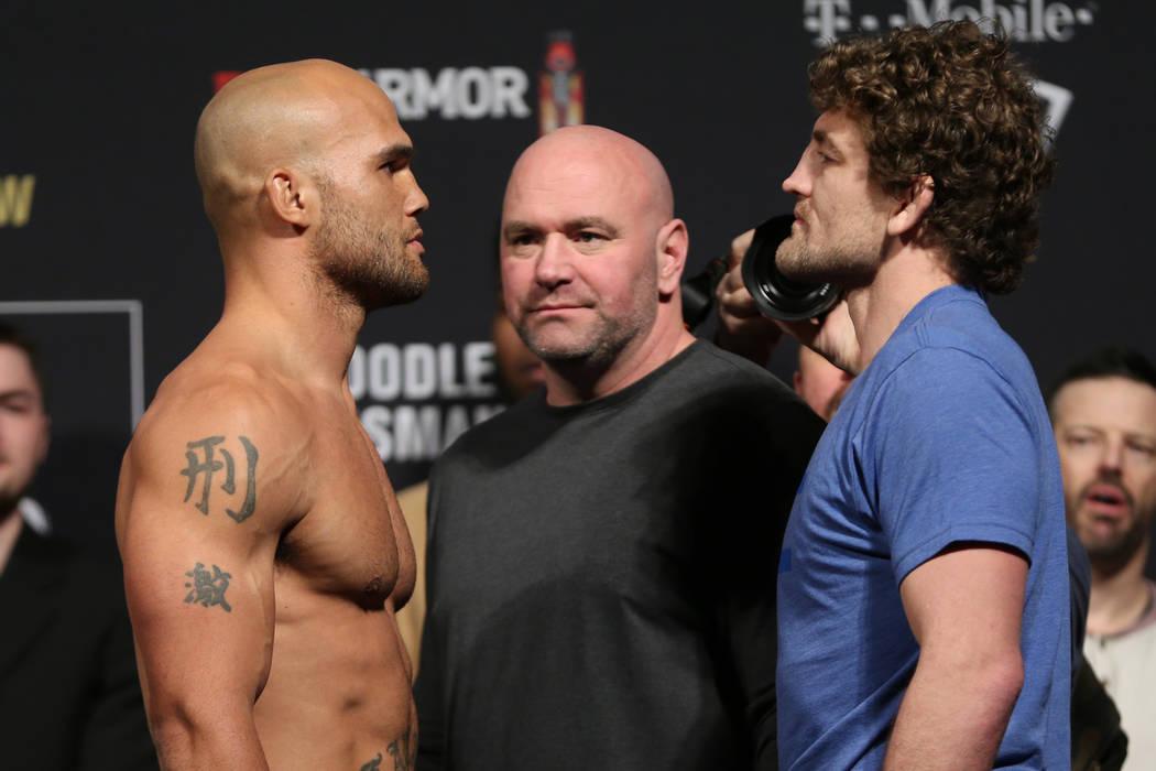 Robbie Lawler, left, and Ben Askren, pose during the ceremonial UFC 235 weigh-in event at T-Mobile Arena in Las Vegas, Friday, March 1, 2019. (Erik Verduzco/Las Vegas Review-Journal) @Erik_Verduzco