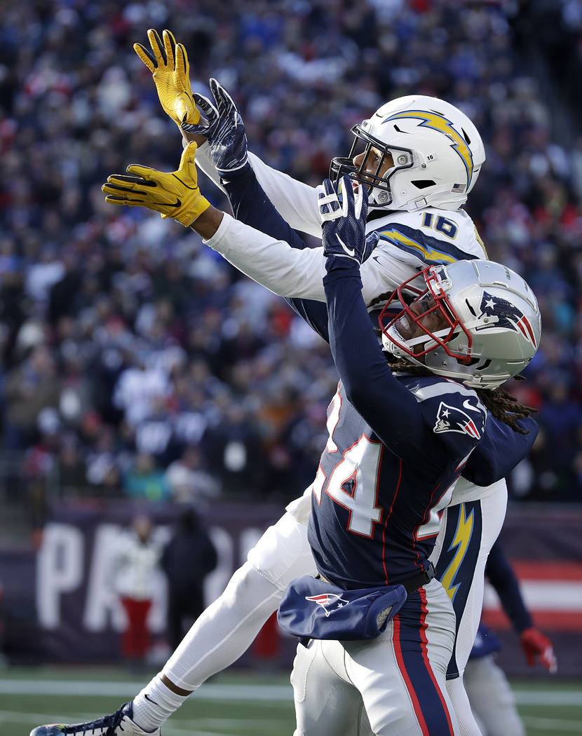 Los Angeles Chargers wide receiver Tyrell Williams (16) reaches for a pass as New England Patriots defensive back Stephon Gilmore (24) defends during the first half of an NFL divisional playoff fo ...