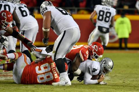 Kansas City Chiefs linebacker Justin Houston (50) sacks Oakland Raiders quarterback Derek Carr (4) during the second half of an NFL football game in Kansas City, Mo., Sunday, Dec. 30, 2018. (AP Ph ...