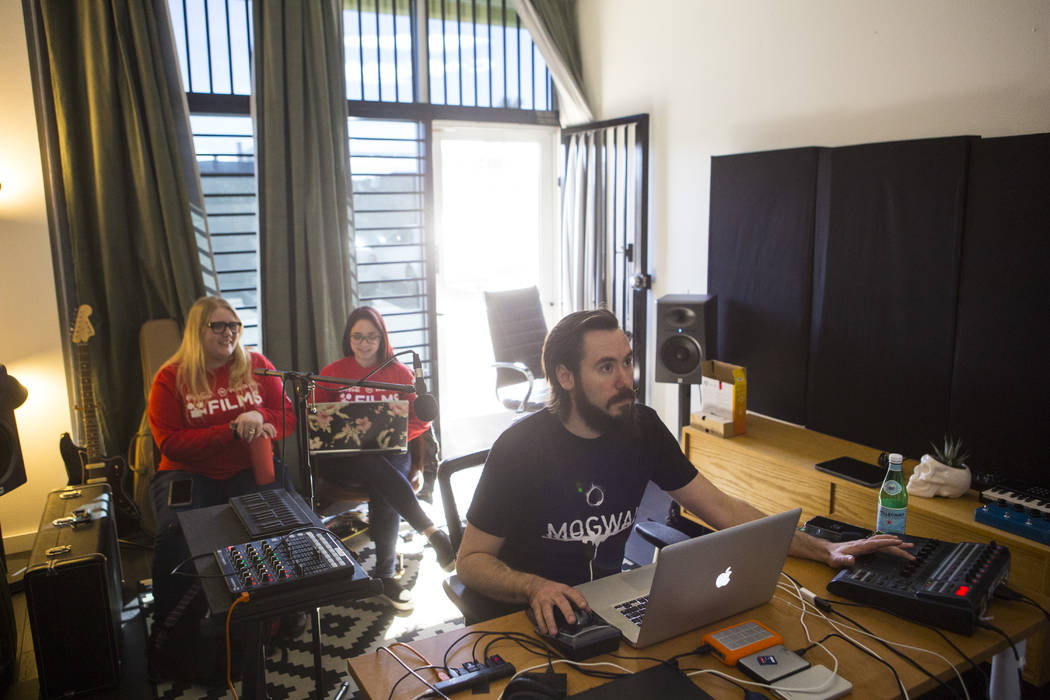 UNLV film students Nicolle Peterson, left, and Lily Campisi watch as sound designer Benton Corder works on their project at Light Forge Studios in Las Vegas on Wednesday, Feb. 27, 2019. The two st ...