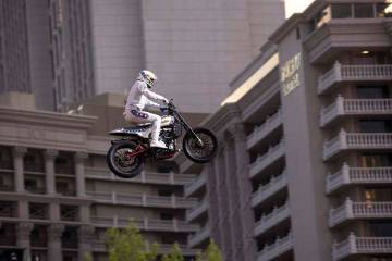 """Travis Pastrana jumps over the fountains at Caesars Palace on an Indian Scout FTR750 motorcycle during """"Evel Live,"""" a three-hour live tribute show to stuntman Evel Knievel, in Las Vegas on Sunday, ..."""