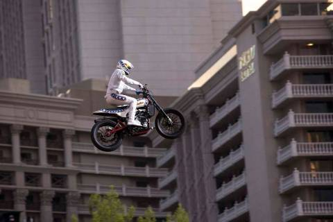 "Travis Pastrana jumps over the fountains at Caesars Palace on an Indian Scout FTR750 motorcycle during ""Evel Live,"" a three-hour live tribute show to stuntman Evel Knievel, in Las Vegas on Sunday, ..."