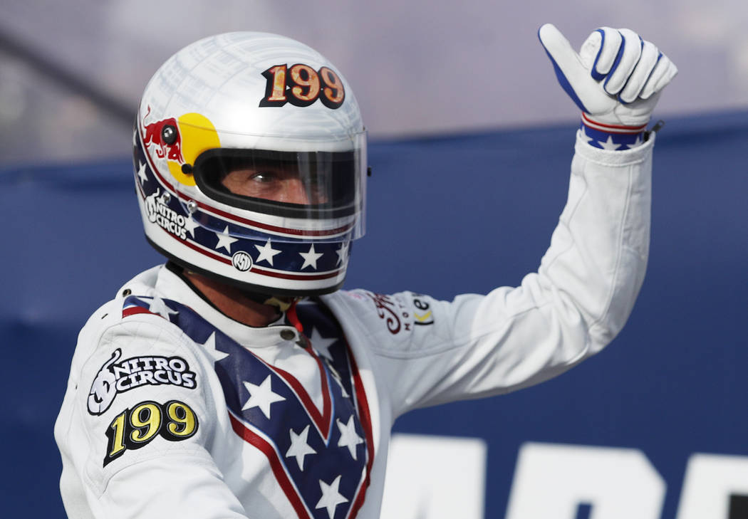 Travis Pastrana celebrates after jumping a row of crushed cars on a motorcycle Sunday, July 8, 2018, in Las Vegas. Pastrana is attempting to recreate three of Evel Knievel's iconic motorcycle jump ...