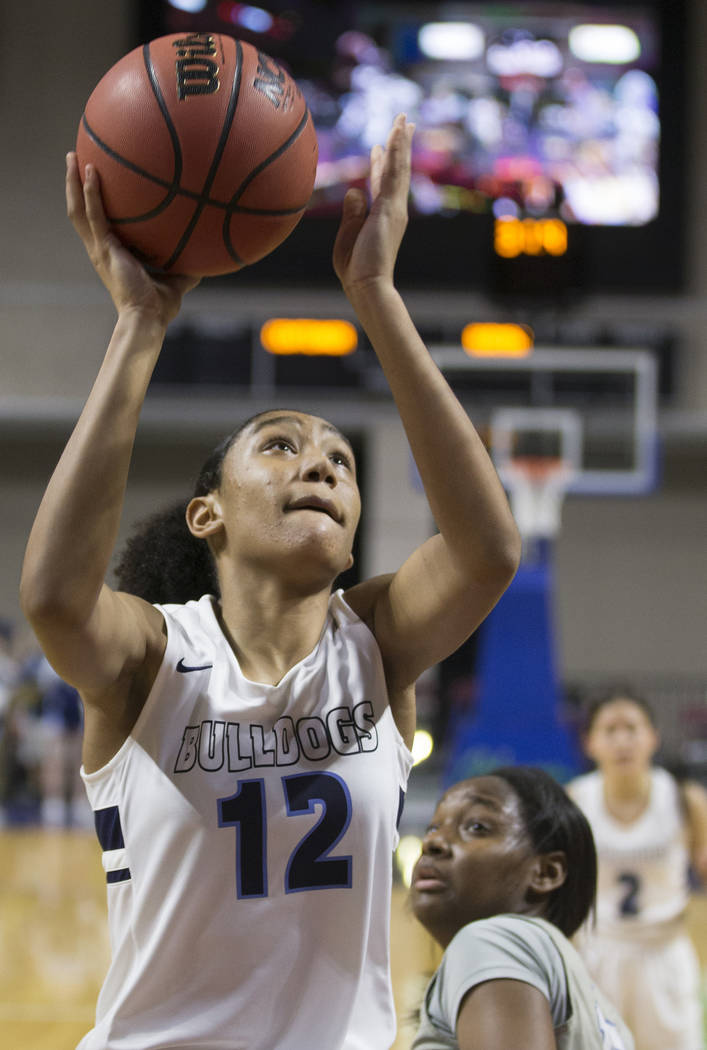 Centennial junior Aishah Brown (12) converts a fast-break layup during the Bulldogs Class 4A girls state championship game with Bishop Gorman on Friday, March 1, 2019, at Orleans Arena, in Las Veg ...