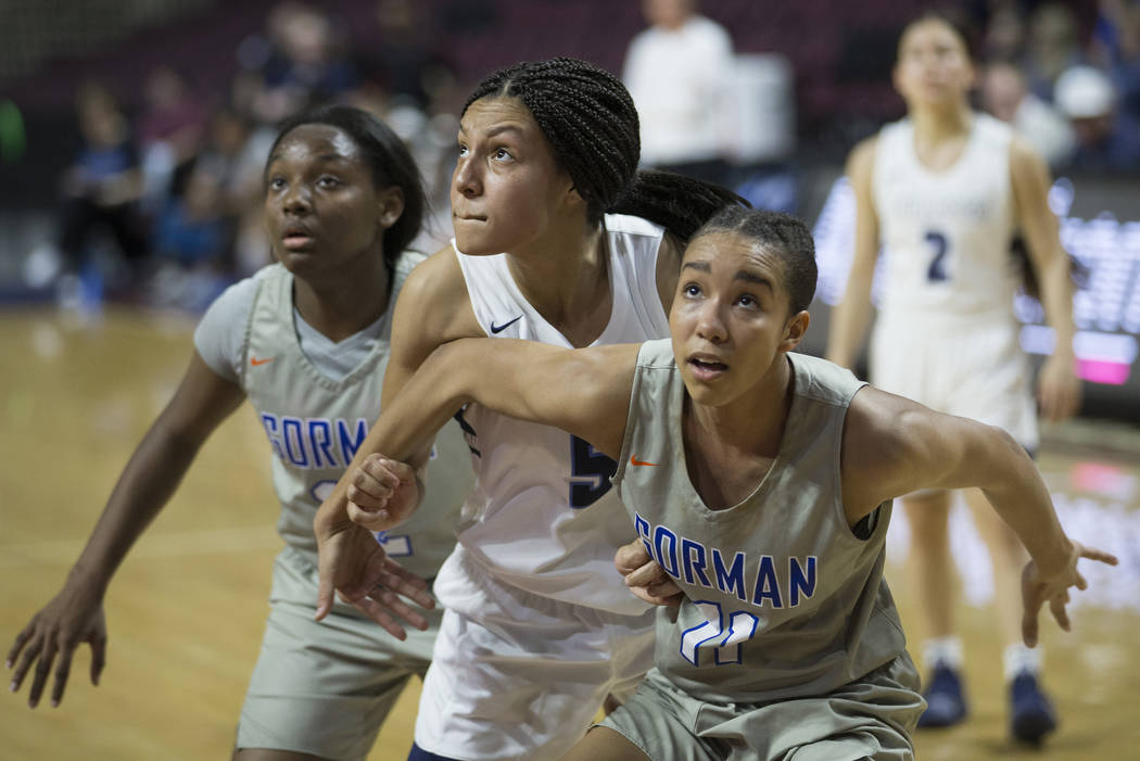 Bishop Gorman senior Olivia Smith (11) boxes out Centennial junior Jade Thomas (5) in the second quarter of the Class 4A girls state championship game on Friday, March 1, 2019, at Orleans Arena, i ...