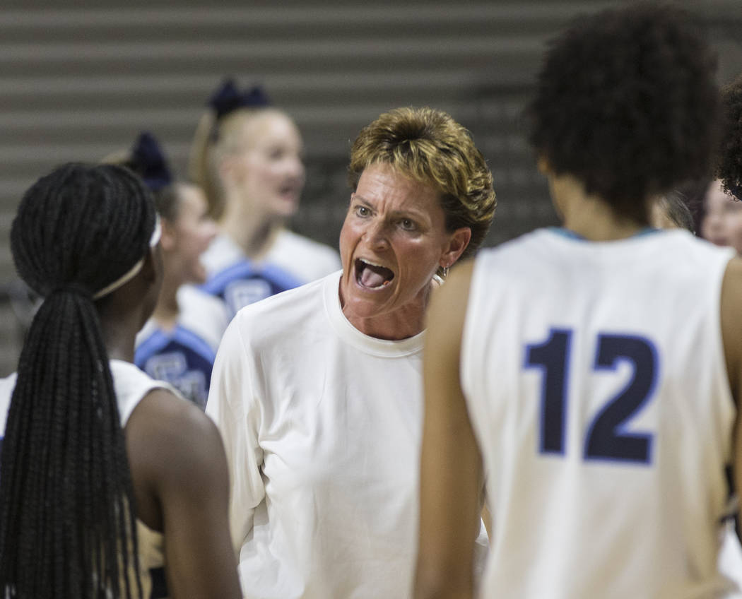 Centennial head coach Karen Weitz fires up her team in the first quarter during the Bulldogs Class 4A girls state championship game with Bishop Gorman on Friday, March 1, 2019, at Orleans Arena, i ...