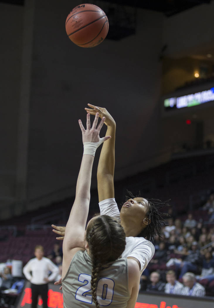 Centennial junior Daejah Phillips (15) shoots a jump shot over Bishop Gorman senior Tierney Holcombe (20) in the second quarter of the Class 4A girls state championship game on Friday, March 1, 20 ...