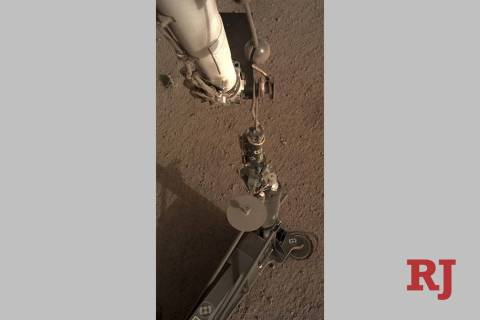 This photo provided by NASA/JPL-Caltech shows an image acquired by NASA's InSight Mars lander using its robotic arm-mounted, Instrument Deployment Camera (IDC). (NASA/JPL-Caltech via AP)