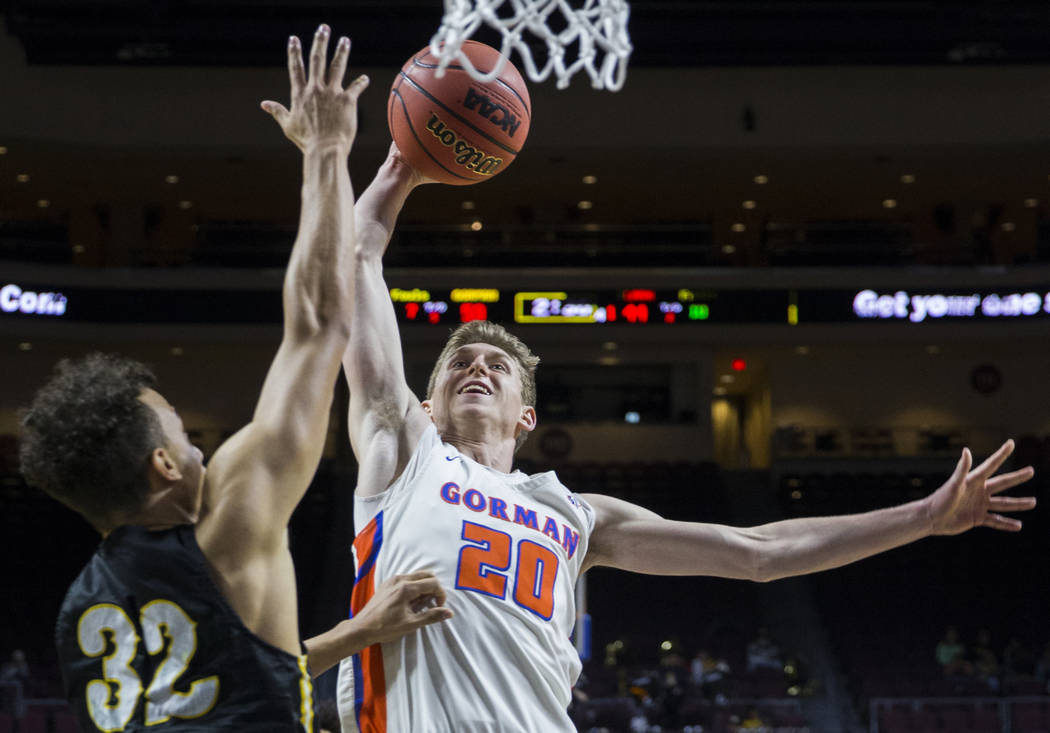 Bishop Gorman junior guard Noah Taitz (20) drives over Clark senior forward Ian Alexander (32) in the fourth quarter of the Class 4A boys state championship game on Friday, March 1, 2019, at Orlea ...