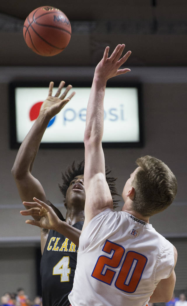 Clark senior guard Carlos Allen (4) shoots a jump shot over Bishop Gorman junior guard Noah Taitz (20) in the third quarter of the Class 4A boys state championship game on Friday, March 1, 2019, a ...