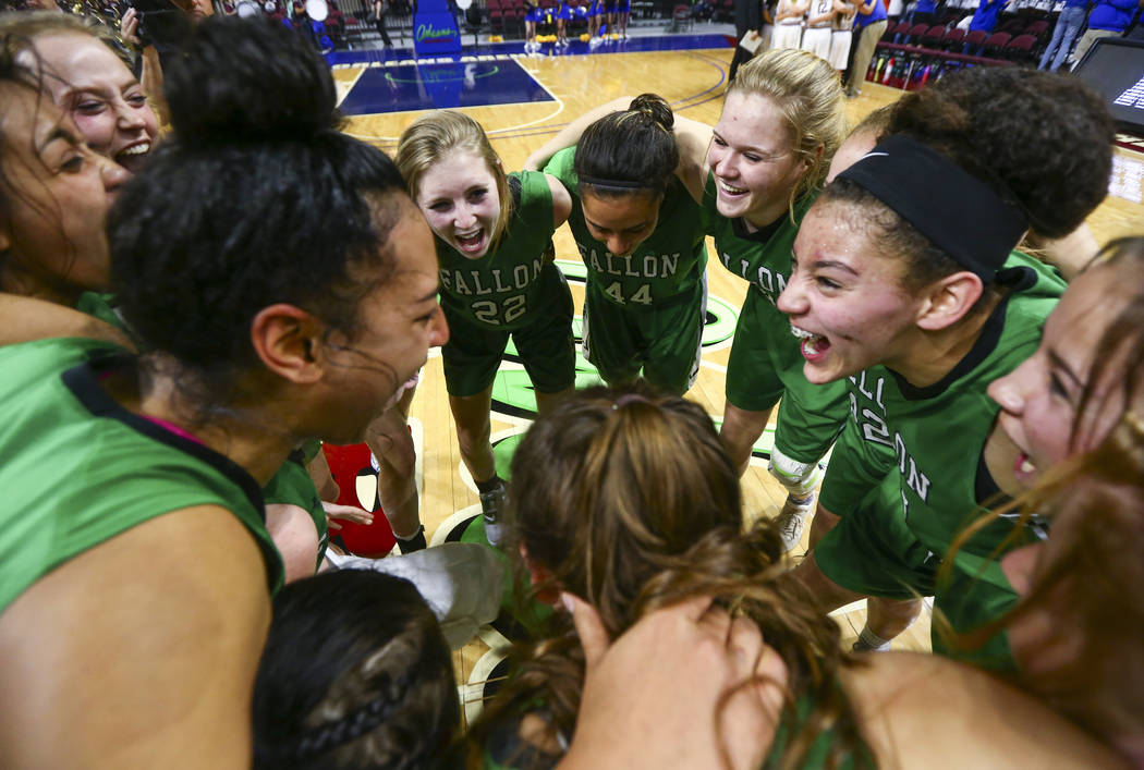 Churchill County players celebrate their win against Moapa Valley in the Class 3A girls basketball state championship game at the Orleans Arena in Las Vegas on Saturday, March 2, 2019. (Chase Stev ...