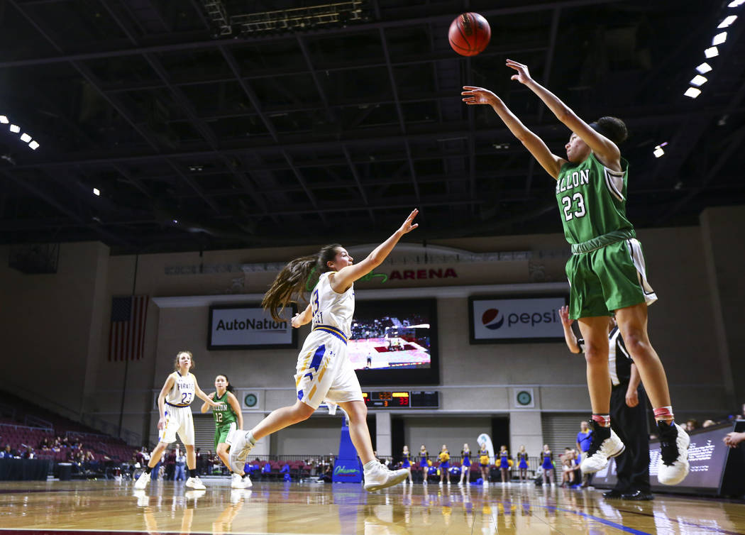 Churchill County's Madison Whitaker (23) shoots over Moapa Valley's Emilie Barraza (13) during the second half of the Class 3A girls basketball state championship game at the Orleans Arena in Las ...