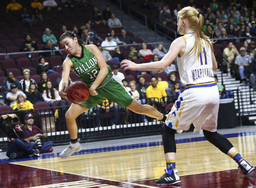 Churchill County's Alexis Jarrett (12) jumps to keep the ball in against Moapa Valley's Kaitlyn Anderson (11) during the second half of the Class 3A girls basketball state championship game at the ...