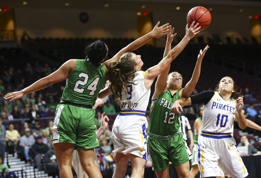 Churchill County's Leta Otuafi (24) and Alexis Jarrett (12) battle for a rebound against Moapa Valley's Ashlyn Western (3) and Peyton Schraft (10) during the second half of the Class 3A girls bask ...