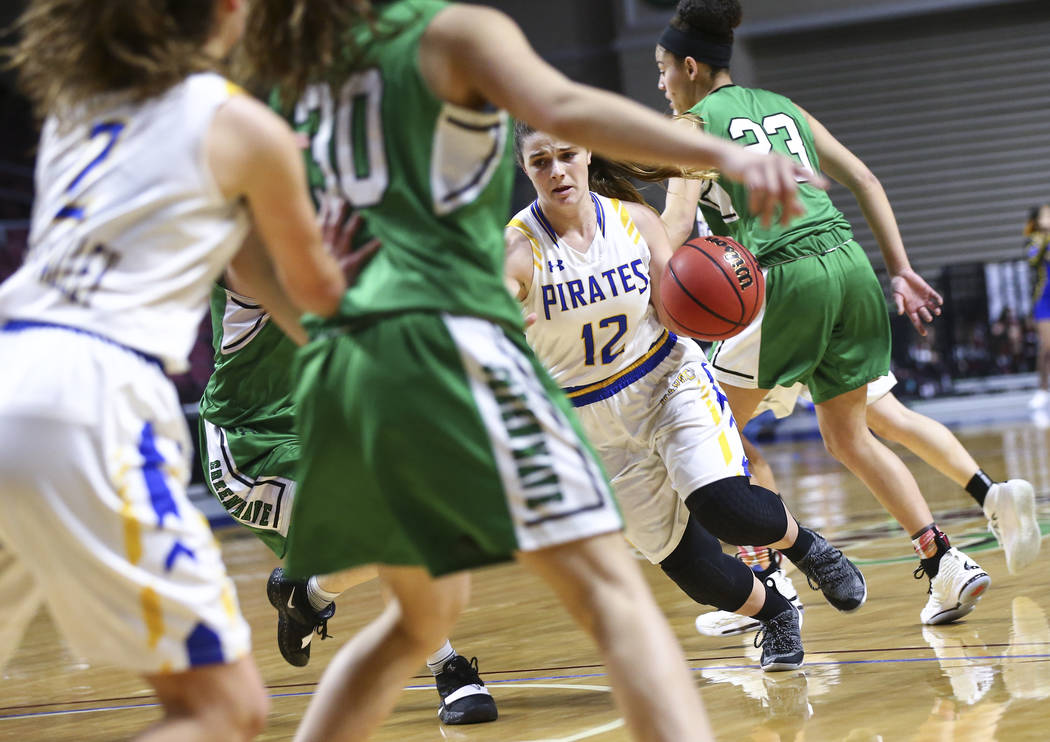 Moapa Valley's Lainey Cornwall (12) moves the ball against Churchill County during the first half of the Class 3A girls basketball state championship game at the Orleans Arena in Las Vegas on Satu ...