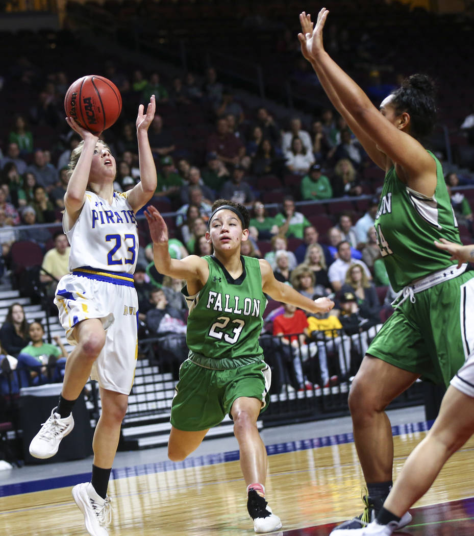 Moapa Valley's Emma Humes (23) shoots against Churchill County's Madison Whitaker (23) during the first half of the Class 3A girls basketball state championship game at the Orleans Arena in Las Ve ...