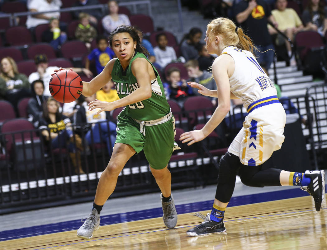 Churchill County's Leilani Otuafi (20) moves the ball around Moapa Valley's Kaitlyn Anderson (11) during the second half of the Class 3A girls basketball state championship game at the Orleans Are ...