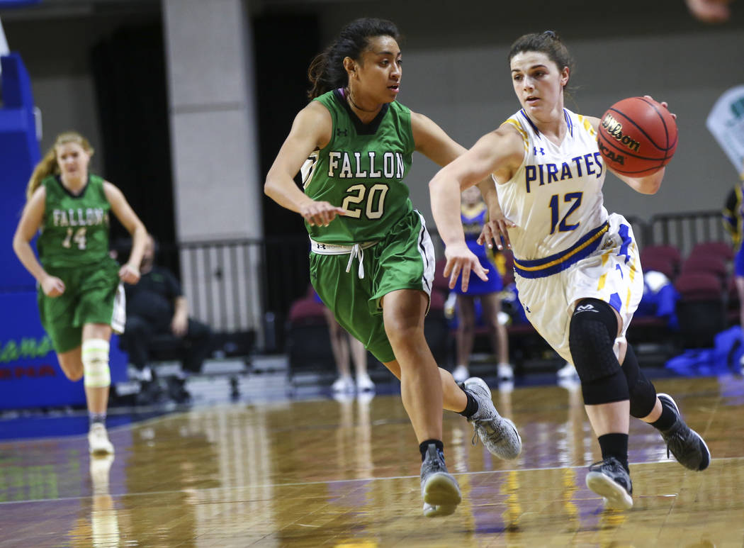 Moapa Valley's Lainey Cornwall (12) drives to the basket against Churchill County's Leilani Otuafi (20) during the first half of the Class 3A girls basketball state championship game at the Orlean ...