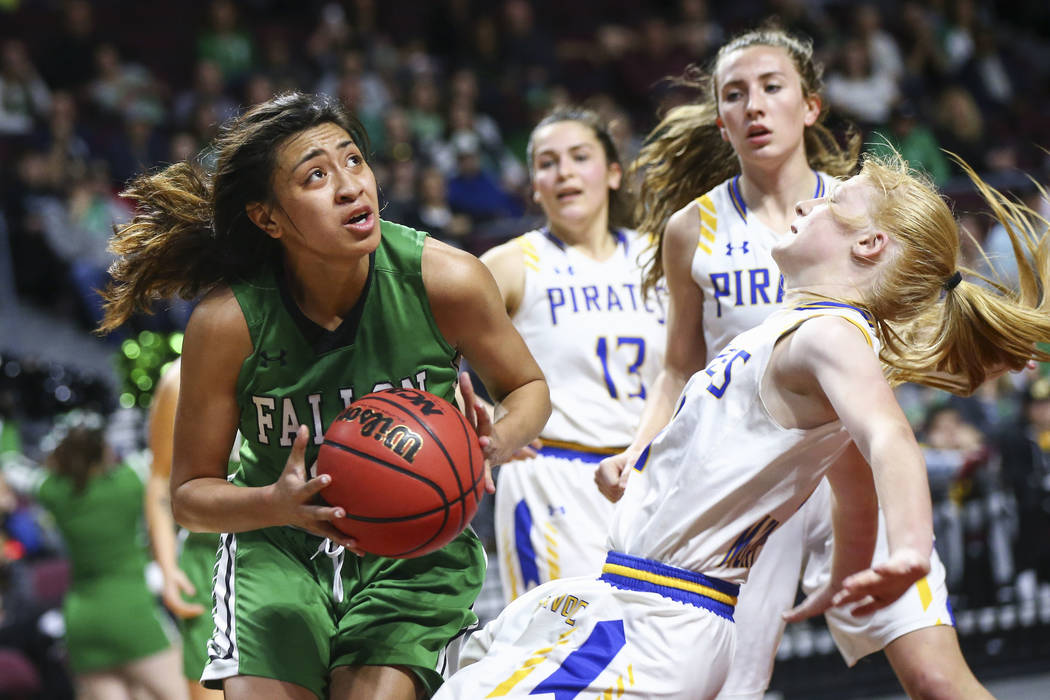 Churchill County's Leilani Otuafi goes to the basket against Moapa Valley's Kaitlyn Anderson during the second half of the Class 3A girls basketball state championship game at the Orleans Arena in ...