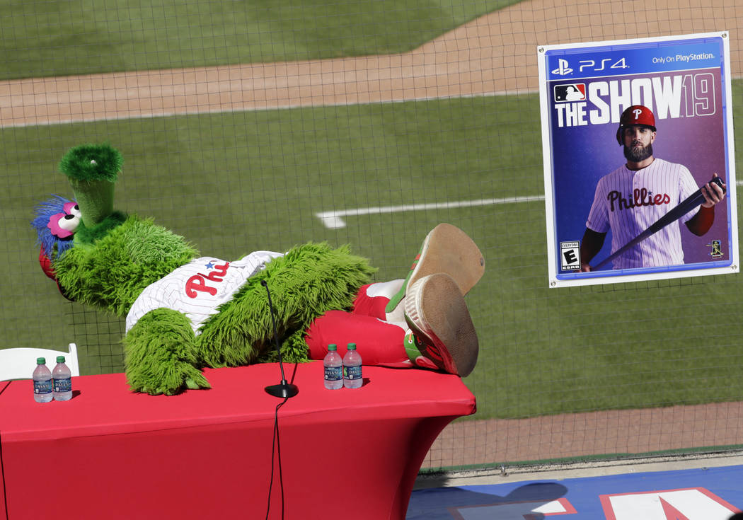 The Philadelphia Phillies mascot Phanatic waits for a news conference where Bryce Harper was introduced as a Philadelphia Phillies player at the team's spring training baseball facility, Saturday, ...