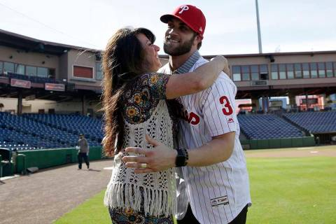 Bryce Harper, right, hugs his mother Sheri after being introduced as a Philadelphia Phillies player during a news conference at the Philadelphia Phillies spring training baseball facility, Saturda ...