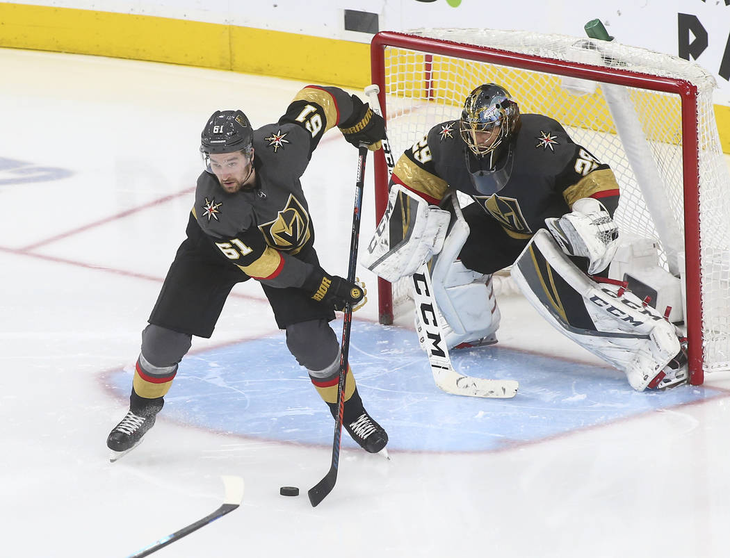 Golden Knights right wing Mark Stone (61) moves the puck in front of goaltender Marc-Andre Fleury (29) during the third period of an NHL hockey game against the Dallas Stars at T-Mobile Arena in L ...