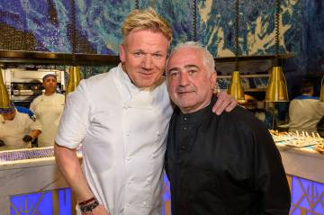 Star chefs Gordon Ramsay and Guy Savoy are shown at Hell's Kitchen's one-year anniversary party at Caesars Palace on Friday, March 1, 2019. (Caesars Entertainment)
