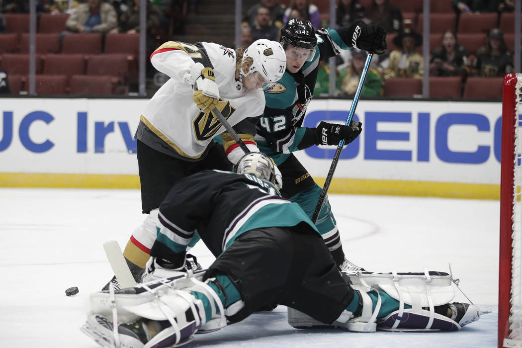 Anaheim Ducks goaltender John Gibson, bottom, makes a save against Vegas Golden Knights' William Karlsson during the first period of an NHL hockey game Friday, March 1, 2019, in Anaheim, Calif. (A ...