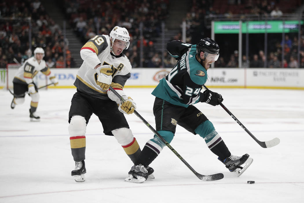 Anaheim Ducks' Carter Rowney, right, is pressured by Vegas Golden Knights' Reilly Smith during the second period of an NHL hockey game Friday, March 1, 2019, in Anaheim, Calif. (AP Photo/Jae C. Hong)